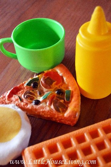 keep a small bag with play food and dishes separate for restaurants and during phone calls