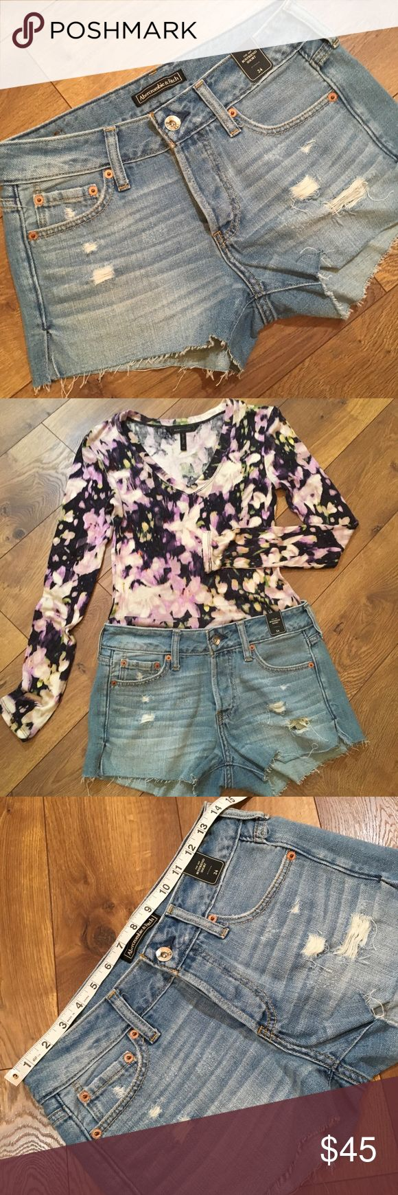 """DISTRESSED ABERCROMBIE BOYFRIEND SHORT Distressed """"The Boyfriend Short"""" PLEASE LOOK AT MEASUREMENTS. Labeled 24 waist but they are too big on me and I wear a 25. inseam 3"""" rise 9""""   Light blue 💥see tag no lowball please Abercrombie & Fitch Shorts Jean Shorts"""