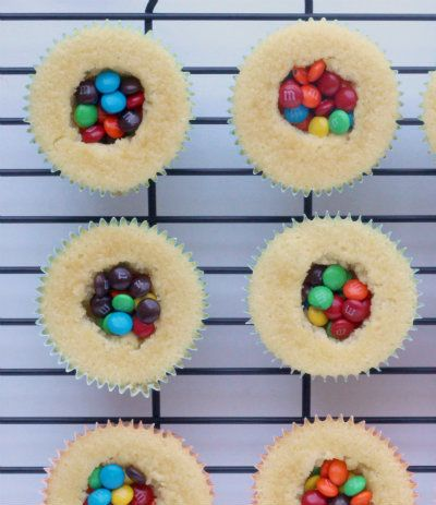 Vanilla Cupcakes with a Surprise Inside! perfect for party's or as a different afternoon snack for the kiddies.
