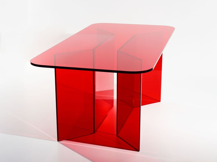 #REDTABLE. Table in extra-clear laminated cut glass with transparent coloured film.