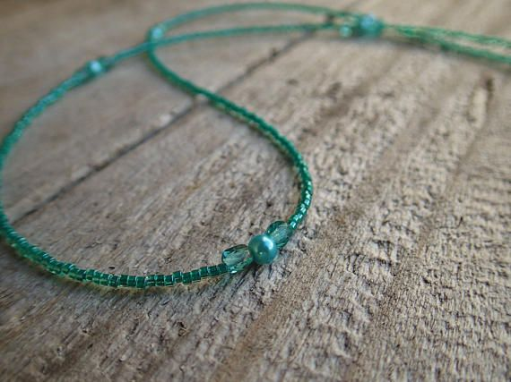 A calming combination of Aqua glass seed beads, faceted crystals, and pearls create this delicate tassel necklace. The colour Aqua represents clarity of thought, emotional balance, spiritual grounding and tranquility - perfect for peaceful meditation! Inspired by the Mala prayer bead style, this is a longer necklace that fits easily over your head and at approximately 24 inches (61cm) it is mid length with the tassel adding 3.5 inches to the bottom.