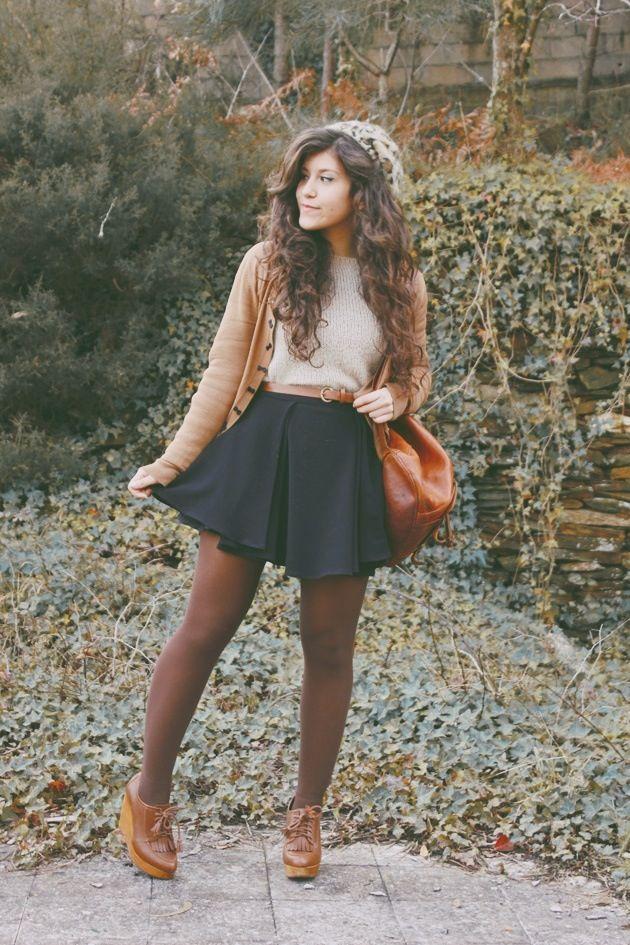 sheer black tights + black pleated high waisted skirt + white shirt + mustard cardigan + brown crossbody + cognac booties