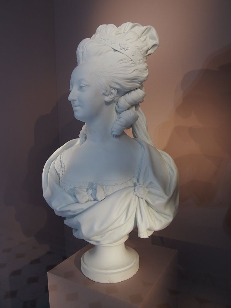 Such a bust of Marie-Antoinette was a porcelain cookie manufactured for mass consumption -- expensive, but still affordable. This particular copy belonged to the Russian ambassador, Prince Kourakin.