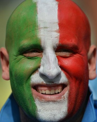 An Italian football fan cheers before the start of the Euro 2012 championships football match Spain vs Italy
