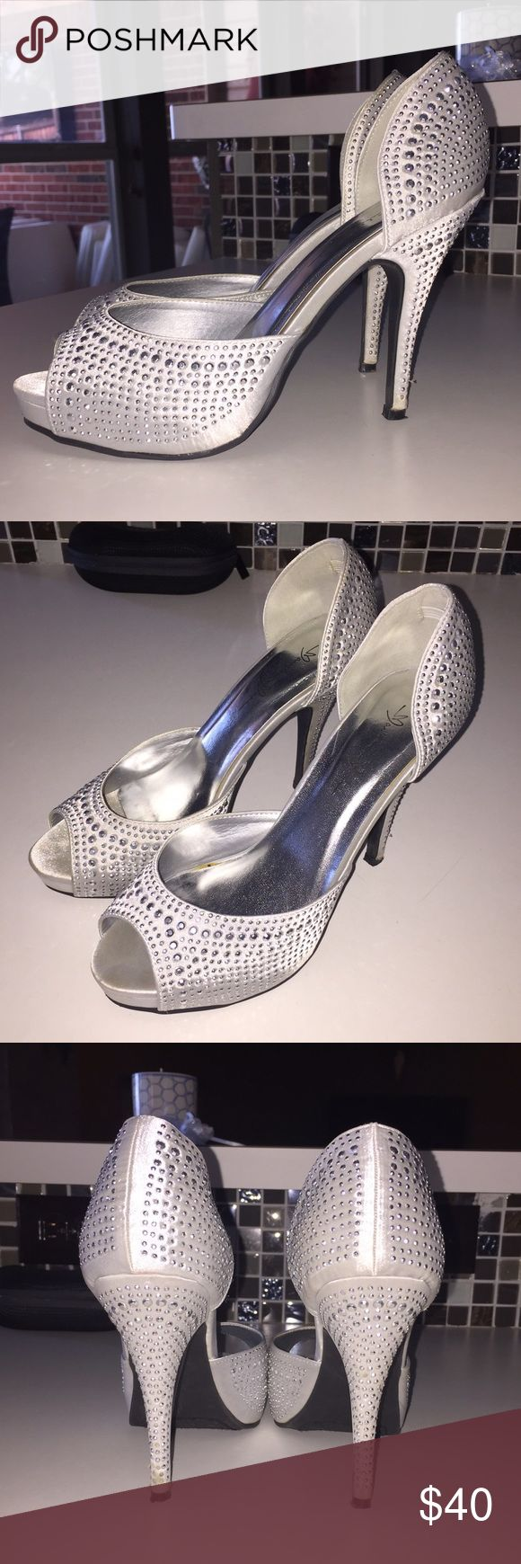 Silver sparkly heels Silver satin peep toe with studs, 4 inches, worn once for formal event. Fits more like a 7 1/2 marichi mani  Shoes Heels