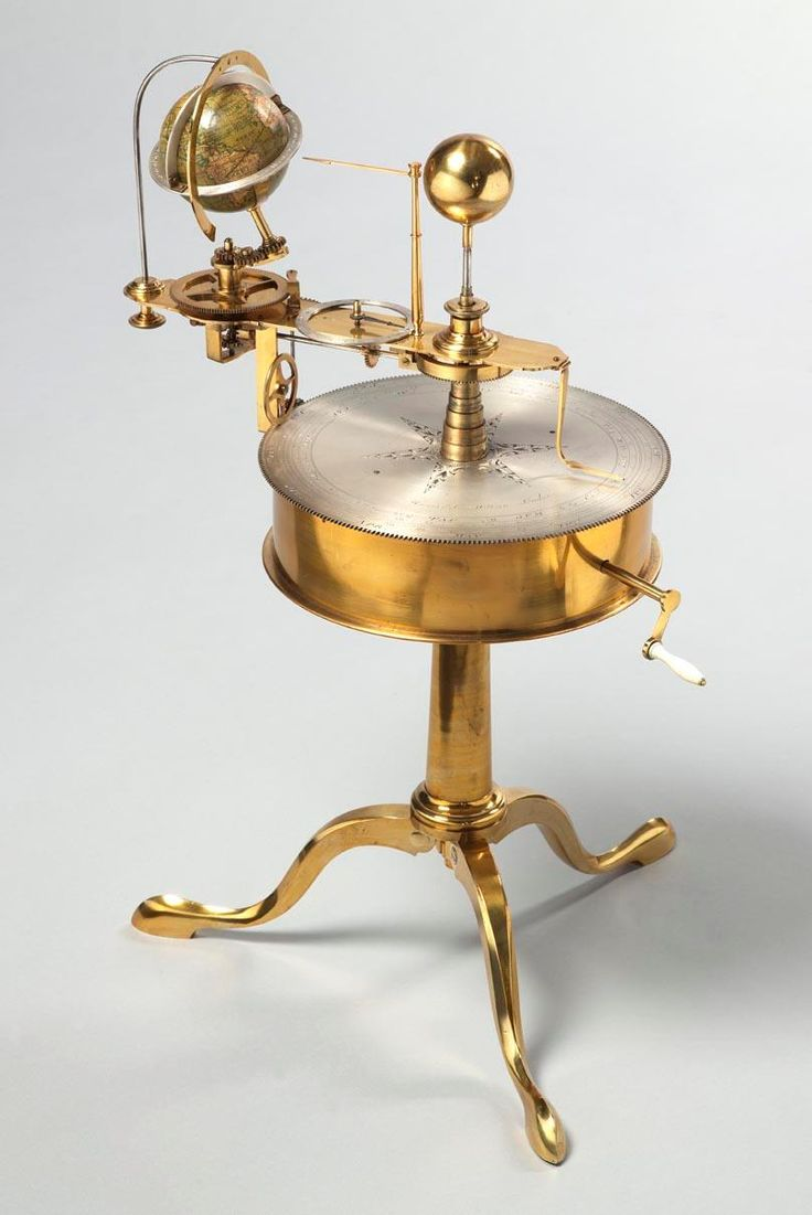 A drum orrery by Harris & Co. circa 1820. The globe is labelled, Lane and Co. Benjamin Martin designed the drum type orrery. The mechanical works of this orrery are housed in a brass drum with a central fixed brass sun and articulated mechanical brass armatures mounted with ivory spheres representing nine orbiting bodies: Mercury, Venus, Earth, Ceres, Mars, Pallas Jupiter, Saturn and Uranus. The Earth, Jupiter, Saturn and Neptune are displayed with their separate orbiting moons..