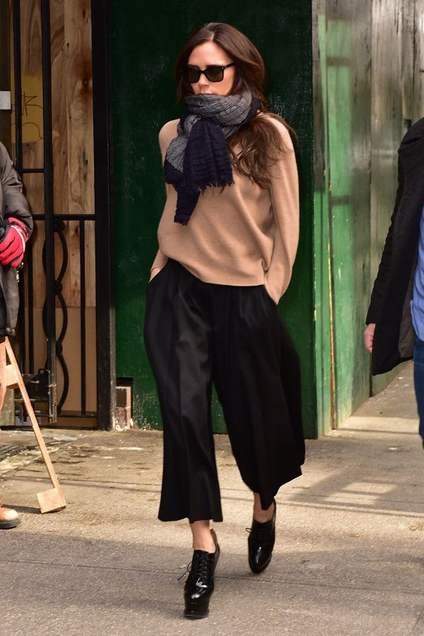 Victoria Beckham in a camel sweater + navy cropped trousers + lace-up oxford heels + scarf