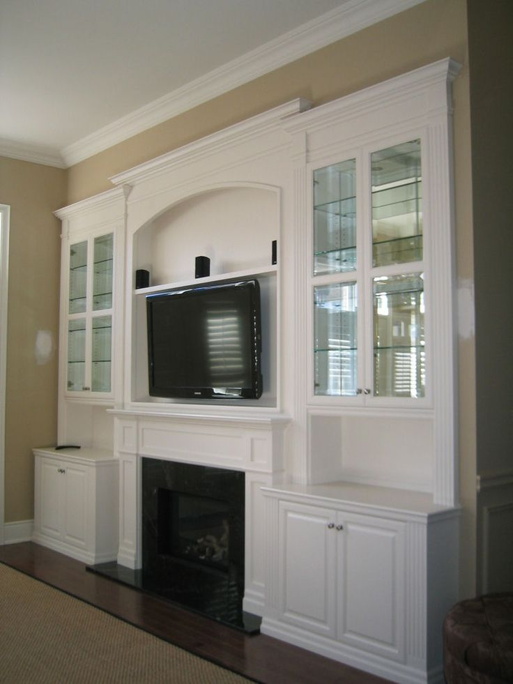 TV Over Fireplace Ideas | TV Over Fireplace - Reeces Fine Woodworking . Now just hav one of the lower cabinets be a facade for a pull out bench so you can put a computer there. And don't like the glass on the upper cabinets as well. Rather have shelves