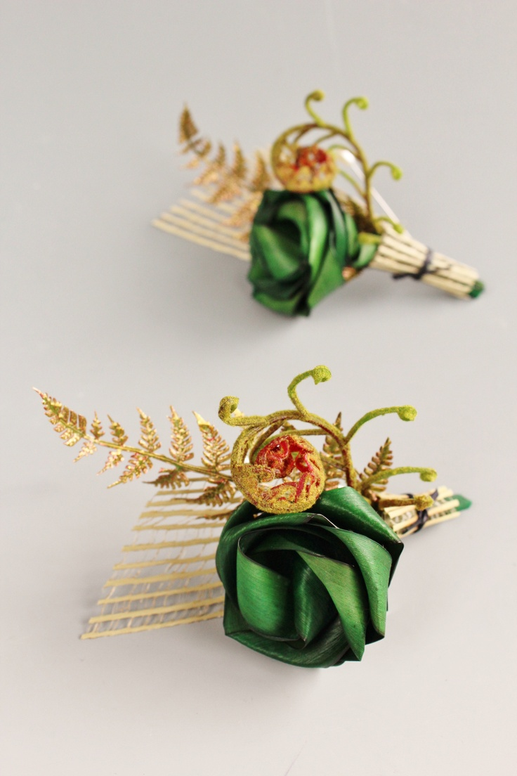 Fan style buttonholes with gold fern & koru by Flaxation