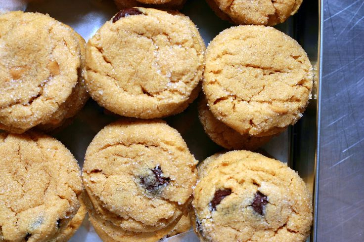 Thick, tender cookies accented with peanut butter and dark chocolate chips, wrapped in glittering edge of fine sugar.