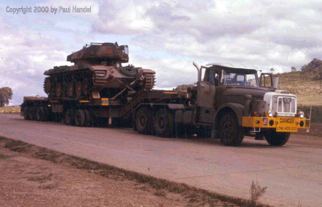 Farewell mate! One of the last Australian Centurion Mk Vs being carried into retirement, 1977. A Scammell Contractor is in the transport role.