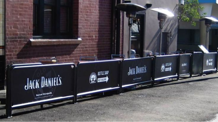 Branded cafe barriers for a bar.