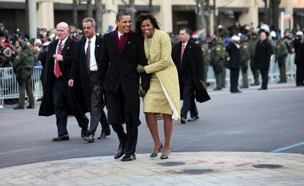 U.S. President Barack Obama and first lady Michelle Obama walk in the inaugural parade following his inauguration as the 44th President of the United States of America on January 20, 2009 in Washington, D.C. Obama is the first African-American to be elected to the office of President in the history of the U.S.