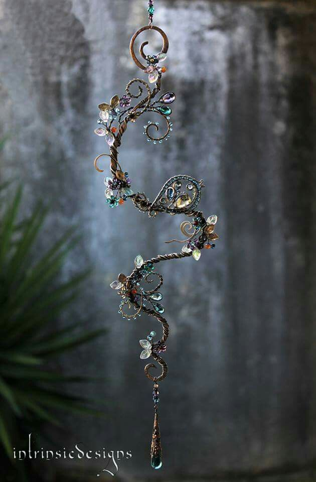 Gorgeous spiraling wire with glass beads.. Would be magical in a window!