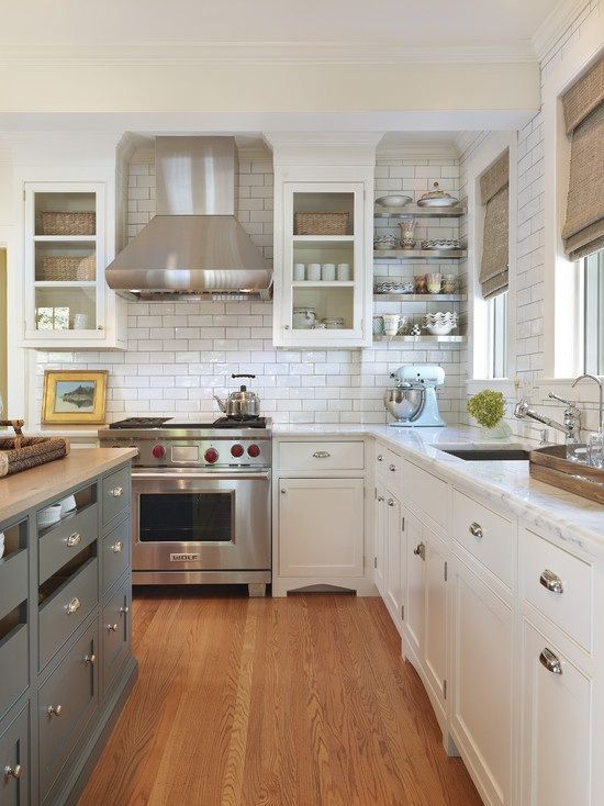 Subway tile with grey grout, two tone cabinetry, floating stainless shelving