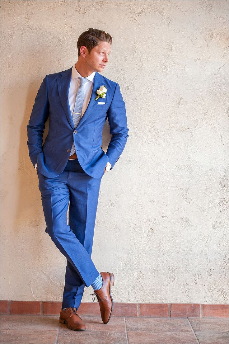 Dapper groom in royal blue suit with saddle color shoes and pale blue tie. All white peony boutonniere - Photos by Drew Brashler Photography