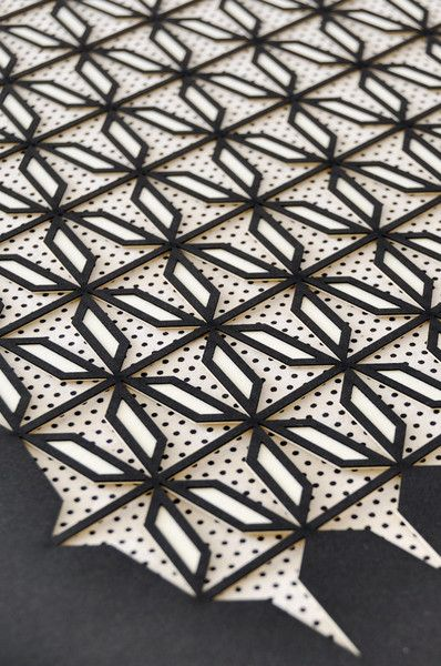 "Multiple layer, laser cut artwork from designer and architect Molly McGrath. Cream and black papers are intricately cut to reveal screen printed rice paper behind. 16"" x 20"" Handmade in San Francisco"