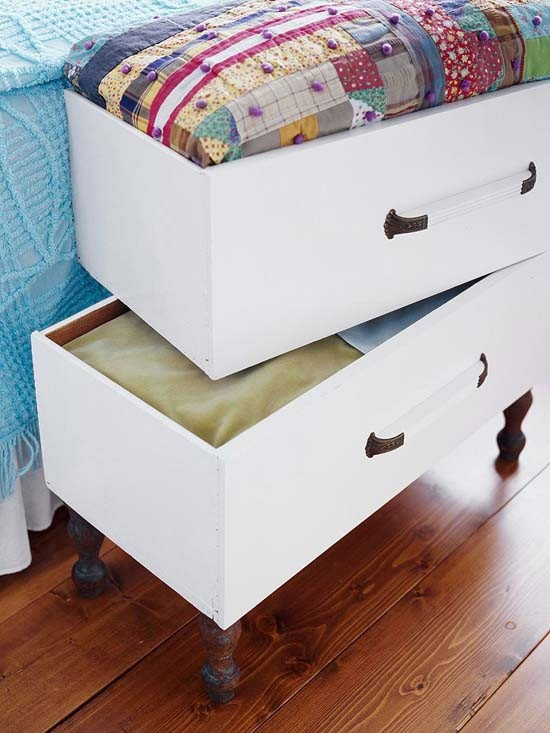 Legs added to old dresser drawers create end of the bed storage.  Could use for a dog bed.