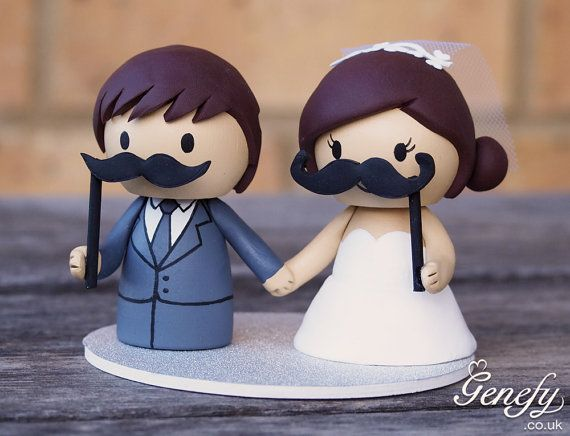 Cute Bride and Groom with moustache prop sticks