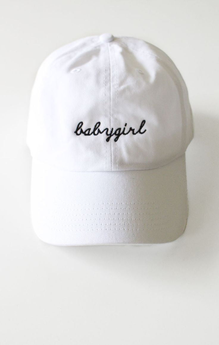 - Description Details: White six panel cap with 'babygirl' embroidery & adjustable back with tri-glide buckle. Brand: NYCT Clothing. 100% Chino Twill. Imported. All accessories are final sale. Sizing: