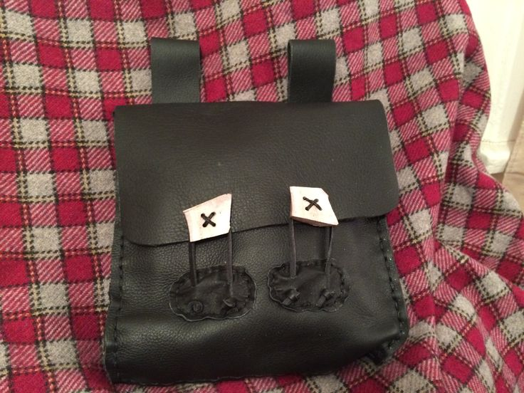 """Black leather hand stitched bag with antler buttons.  The style is the """"Bayard"""" named after a friend who requested certain features."""