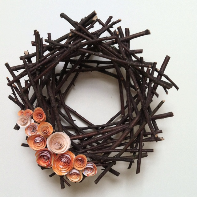 Stick wreath with paper flowers made using the following tutorial: http://jonesdesigncompany.com/flowers/rolled-paper-flowers-tutorial/ .