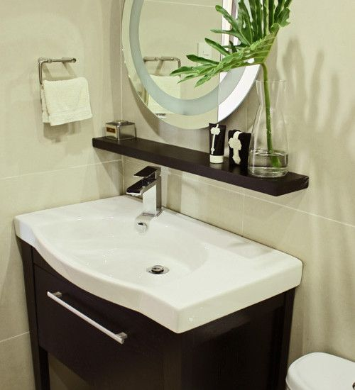 Nice Corner Sink with shelf and Mirror Above. This might make a nice update to the upstairs bath.