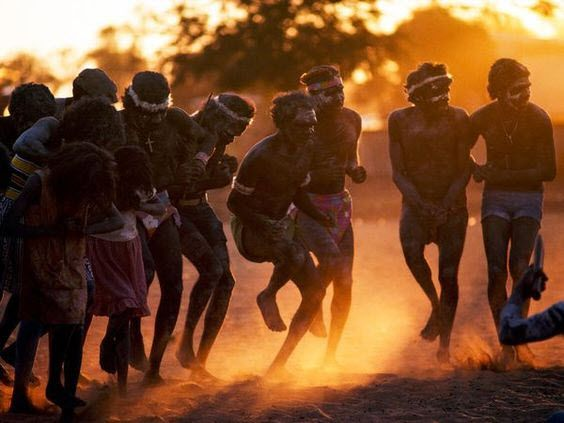 Aboriginal Dancers Aborigines kick up dust in a dance at sunset. The original inhabitants of Australia, Aborigines were there for more than 40,000 years before white men arrived. European settlers brought disease and politics to the continent, severely endangering the Aborigines' distinct culture, language, and lifestyle.