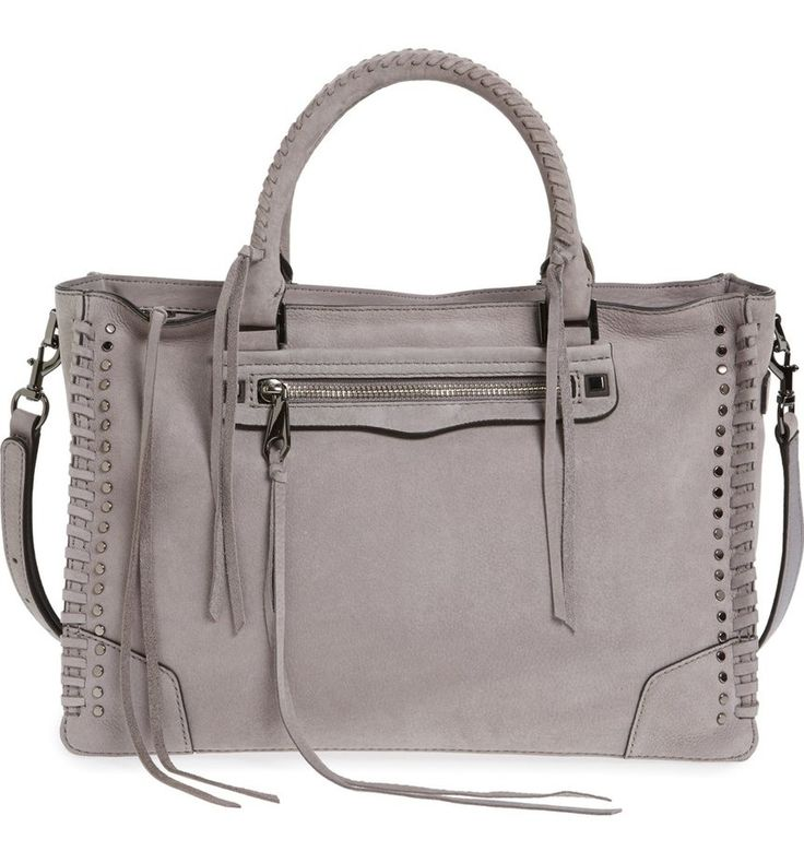 This quintessential Rebecca Minkoff satchel features stud hardware and signature dangling tassels. Whipstitched top handles add texture to the style, while a spacious interior and optional, adjustable strap make this bag perfect for everyday use.