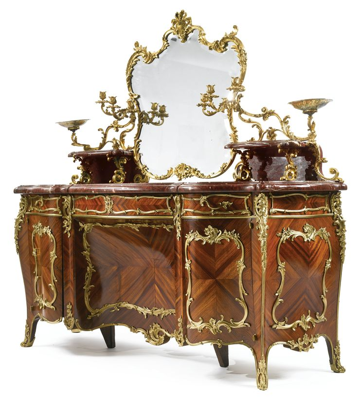 OTT Blaise & ThÉodore Millet 1853-1918 AN IMPRESSIVE LOUIS XV REVIVAL GILT BRONZE MOUNTED KINGWOOD, SATINÉ, MOSS AGATHE AND ROUGE GRIOTTE MARBLE DRESSING TABLE Paris, circa 1890 the swiveling beveled mirror set within a foliate and floral cast frame, surmounted by a plumed crest and flanked by a pair of marble shelves fitted with three light candle arms, the thick molded serpentine marble top above three frieze drawers and a pair of cabinets fitted with one shelf,