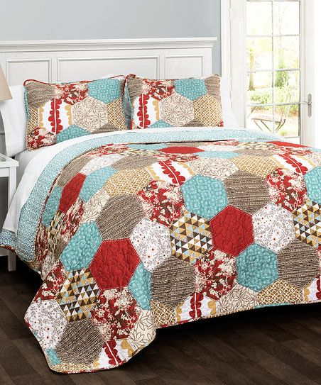 Enliven your bedroom décor with this eye-catching quilt set featuring super-soft material for restful slumber.