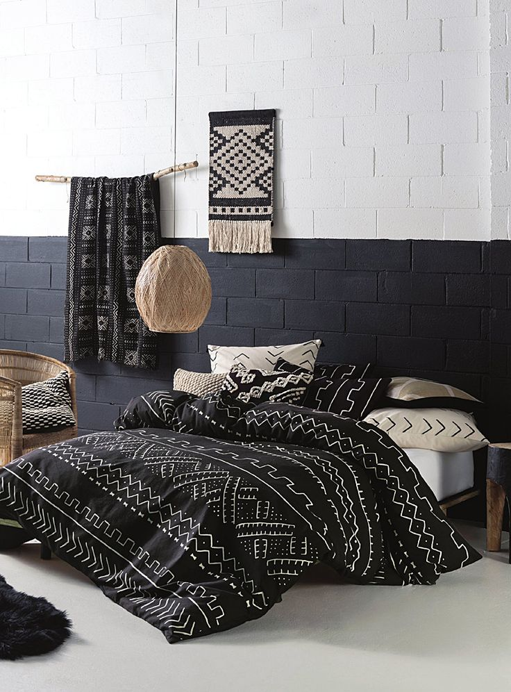 Linen House at Simons Maison. Inspired by African mud cloth fabrics, this relaxed black and white design adds rustic texture to a modern setting. Printed on a natural cotton slub ground, with a plain black reverse. Euro pillow sham sold separately. The set includes: Twin: 1 duvet cover 66&quote; x 90&quote;, 1 pillow sham 20&quote; x 26&quote; Double: 1 duvet cover 84&quote; x 90&quote;, 2 pillow shams 20&quote; x 26&quote; Queen: 1 duvet cover 90&quote; x...