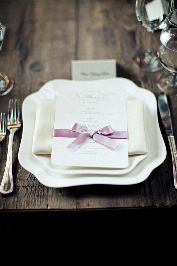 elegant white place setting and menu tied with purple ribbon | photo: clycreation.com