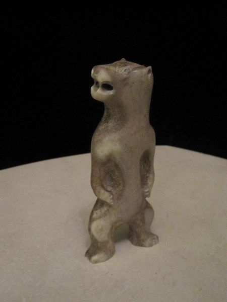 $125 · Inuit / Eskimo unsigned carving of a standing bear hand carved from antler.