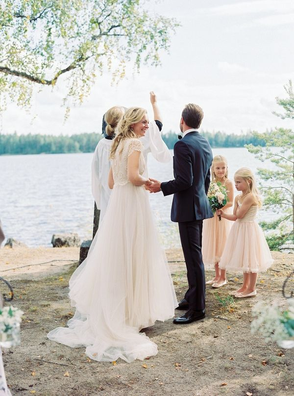 Outdoor wedding ceremony by the lake   2Brides Photography on @blovedblog via @aislesociety