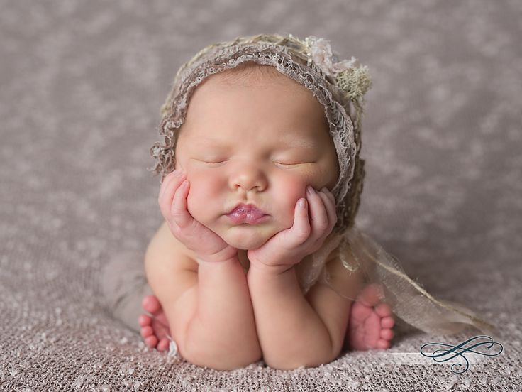 Newborn photographer gainesville fl lovin the light see more baby girl seated with head in hands vintage taupe bonnet with pink flower tieback