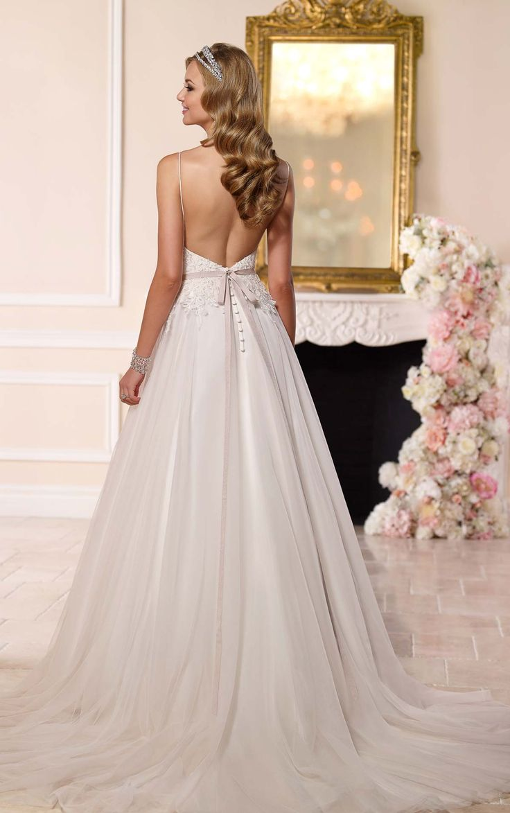 From Stella York: it's sexy spaghetti straps, to its pretty keyhole neckline, and figure-flattering bodice, there truly isn't another dess out there that compares.