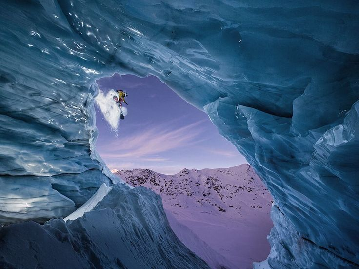 Picture of a snowboarder jumping over an ice cave, Austria