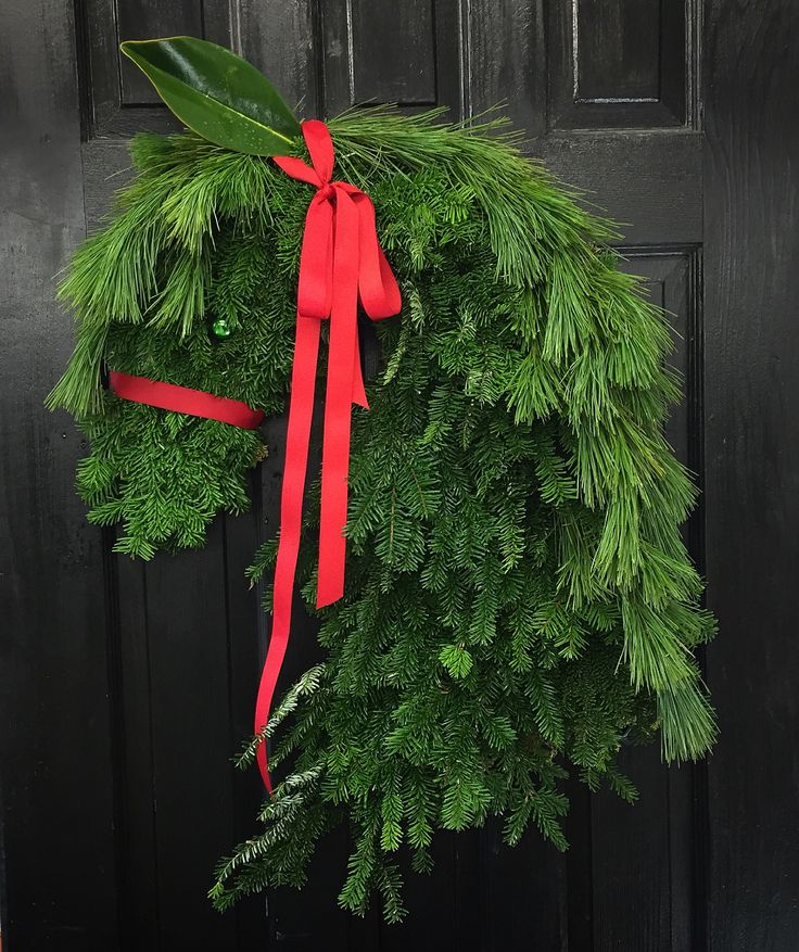 Horse themed door hanging, hand made with fresh winter greenry! By Sharlene Nielsen of frontdoorstories.com