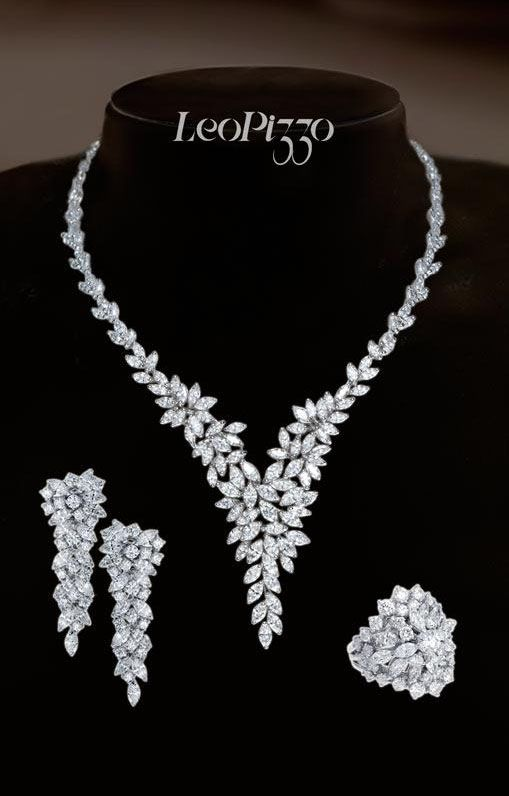 From the Leo Pizzo collection, a stunning floral inspired parure crafted in white gold and diamonds.