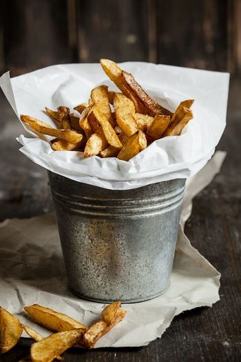 You CAN make crispy french fries at home, as long as you use the proper potatoes and fry them twice. That's right, twice. Trust us, it's the only way.