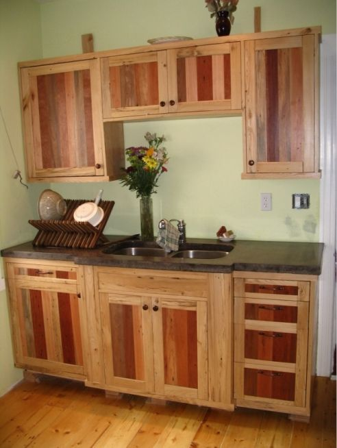 Kitchen cabinets from reclaimed ash and pallets