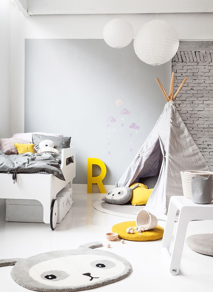 Great modern gender neutral bedroom yellow accent and the exposed brick wall