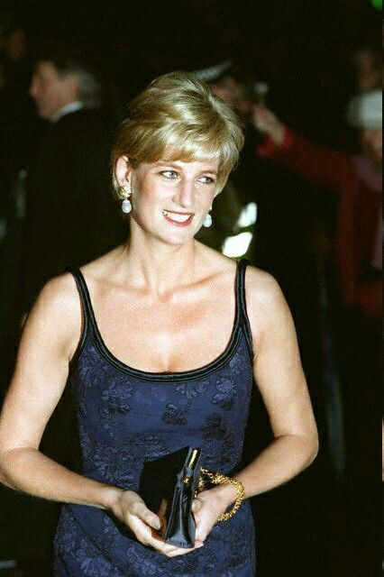 """February 12, 1997: Diana, Princess of Wales attending the """"Love and War"""" premiere at Odeon at Leicester Square, London."""