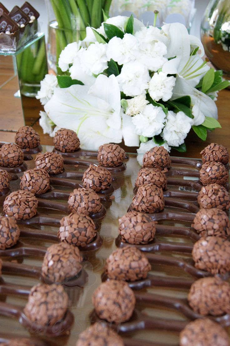 Doces finos: Milk chocolate spoons with a brigadeiro* on top! *tradicional sweet made with condensed milk and cocoa powder but this one in special was made with belgian chocolate!
