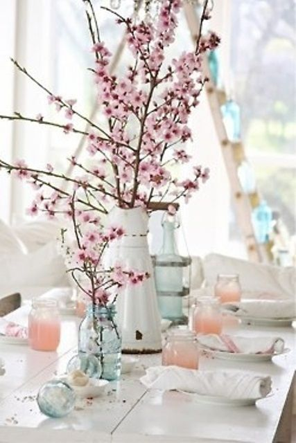 Super easy DIY centerpiece - cherry blossom branches in mason jars and vintage vases. Great for a rustic garden spring wedding theme
