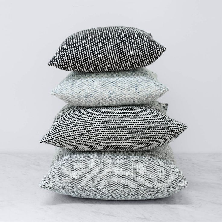 """Hand-loomed using """"wild"""" spun yarn from Donegal, this tweed pillow features a…"""