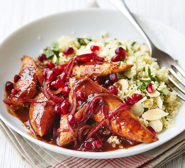 Jazz up chicken breasts in this fruity, sweetly spiced sauce with pomegranate seeds, toasted almonds and tagine paste