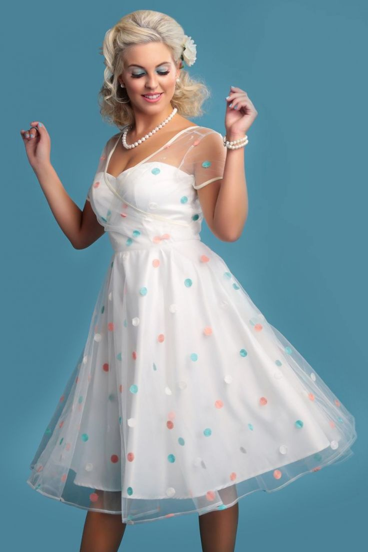 This50s Nina Polka Dot Swing Dressis super cute!  The perfect dress for a summer wedding or any other special occasion where you would want to look elegant and cute! This swing beauty features a polkadot embroidered ivory coloured tulle overlay but the sewn in sateen slip dress ensures you won't reveal too much. The slip dress has a beautiful sweetheart neckline and see through silicon straps to give it a strapless look.Already found the love of your life? If not, this dres...
