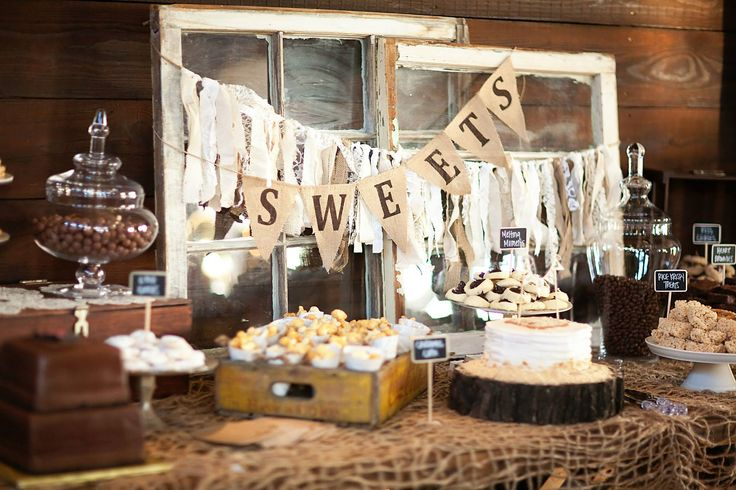 I like the distressed wood accents with the candy buffet to add a more rustic feel.